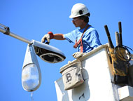 Lineman Repairing a Light